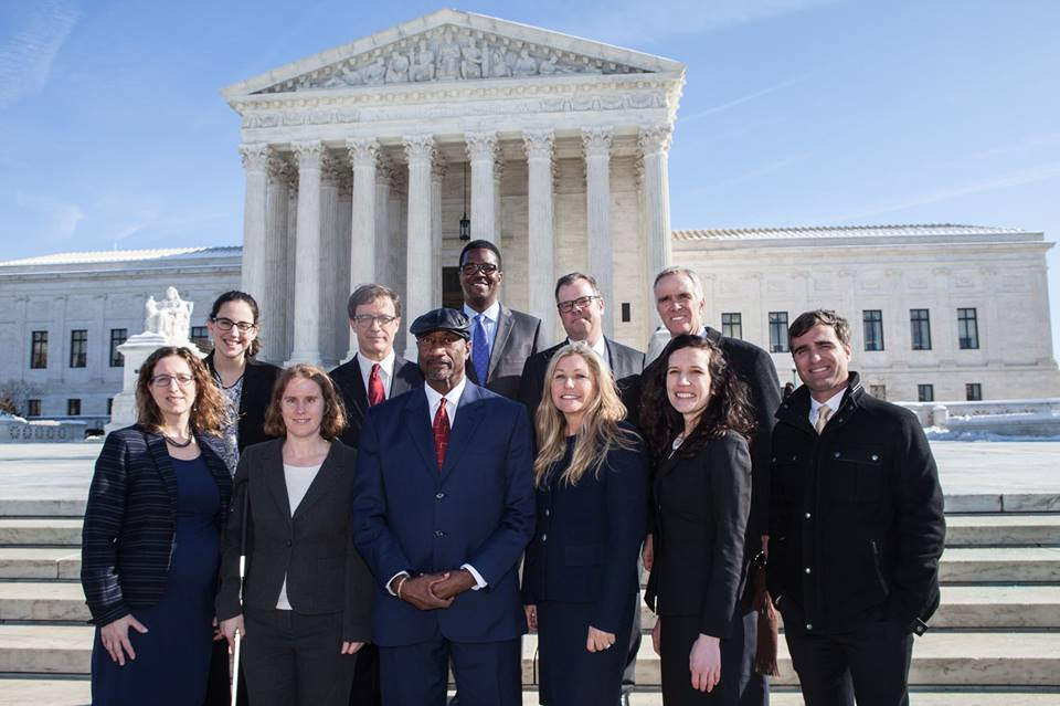 Public Justice Team in front of the Supreme Court